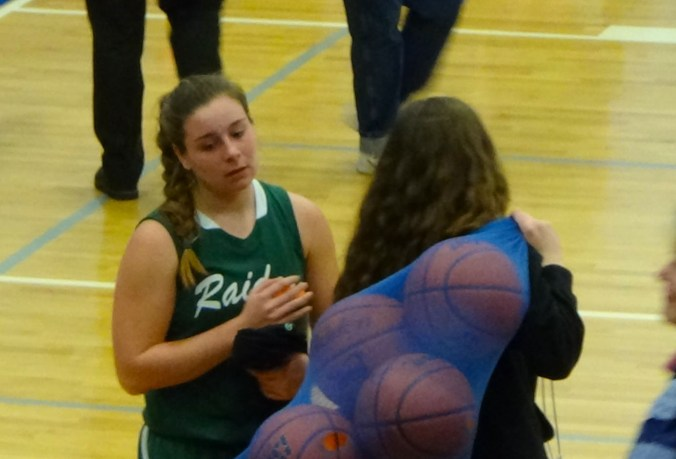 A Twin Valley player prepares to leave the court immediately after the game.