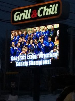 The Exeter Dairy Queen sign congratulating the wrestling team on their recent championship. Photo by Ariane Cain