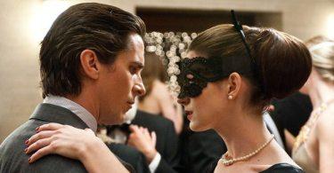 Bruce Wayne (Bale) dancing with Selena (Hathaway)