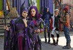 Maleficent (Kristin Chenoweth) her daughter Mal (Dove Cameron)  as Evie (Sofia Carson)  Carlos (Cameron Boyce) and Jay (Booboo Stewart) look on