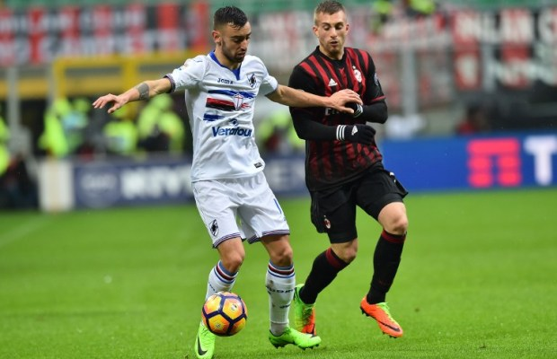 """Sampdoria's midfielder from Portugal  Bruno Fernandes (L) fights for the ball with AC Milan's forward from Spain Gerard Deulofeu during the Italian Serie A football match AC Milan vs Sampdoria at """"San Siro"""" Stadium in Milan on February 5, 2017.   / AFP PHOTO / GIUSEPPE CACACE"""