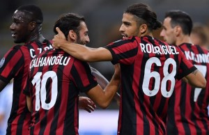 AC Milan's Italian defender Ricardo Rodriguez celebrates with AC Milan's Turkish forward Hakan Calhanoglu (L) after scoring during the Italian Serie A football match AC Milan vs Spal at San Siro stadium in Milan on September 20, 2017.   / AFP PHOTO / MARCO BERTORELLO