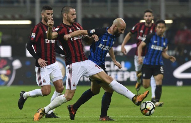 Inter Milan's Spanish midfielder Iglesias Borja Valero vies with AC Milan's Captain Italian defender Leonardo Bonucci (L) during the Italian Serie A football match Inter Milan Vs AC Milan on October 15, 2017 at the 'San Siro Stadium' in Milan.  / AFP PHOTO / MIGUEL MEDINA