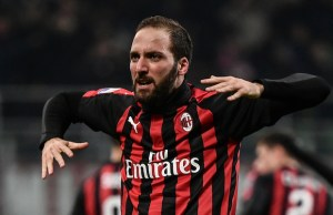 AC Milan's Argentine forward Gonzalo Higuain celebrates after scoring 2-1 during the Italian Serie A football match AC Milan vs Spal on December 29, 2018 at San Siro stadium in Milan. (Photo by Marco BERTORELLO / AFP)
