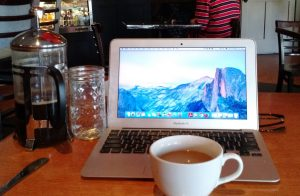 Working from a coffee shop.