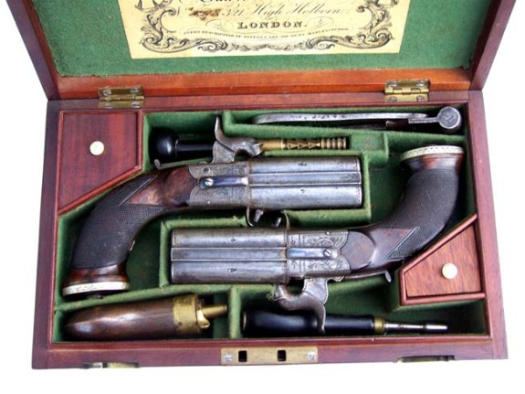 A fine Cased Pair of Over and Under Boxlock Percussion Pistols by John Blisset, London, c. 1840