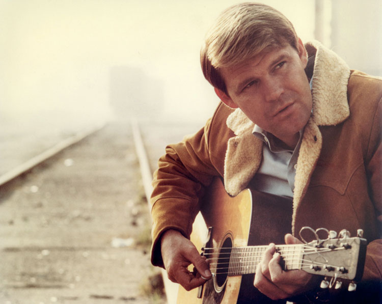 http://acousticguitar.com/video-lesson-remembering-glen-campbell-and-his-acoustic-style/