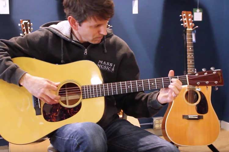 Mike Horan of Mass Street Music in Lawrence, Kansas, demos a Martin D-18 Authentic