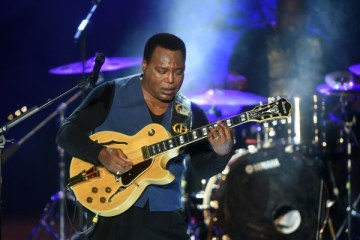 US guitarist, singer, and jazz composer, George Benson performs during the 50th session of the International Carthage Festival on July 16, 2014 at the Roman theater of Carthage near Tunis.    AFP PHOTO / FETHI BELAID AFP PHOTO / FETHI BELAID        (Photo credit should read FETHI BELAID/AFP/Getty Images)