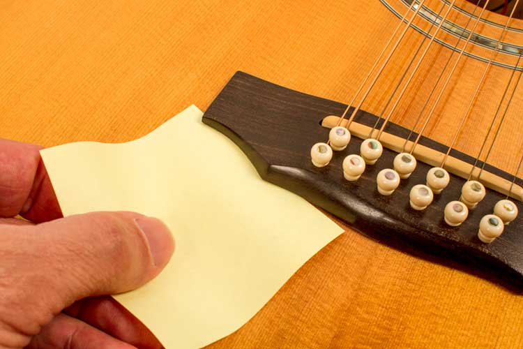 If you can slip a piece of paper under your bridge get thee to a luthier. & Ask the Expert: If Your Guitar Isnu0027t Playing or Feeling Right Check ...