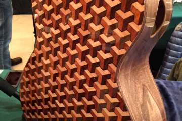 Escher-like marquetry on the back of a Woolson Soundcraft guitar.