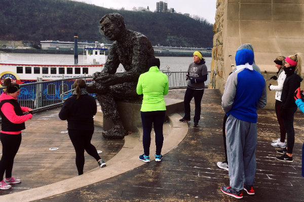 trista yerks leads a guided running tour through a neighborhood in pittsburgh pennsylvania