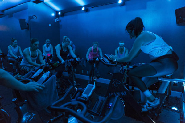 a spinning instructor leads a studio cycling class at steel revolution pittsburgh