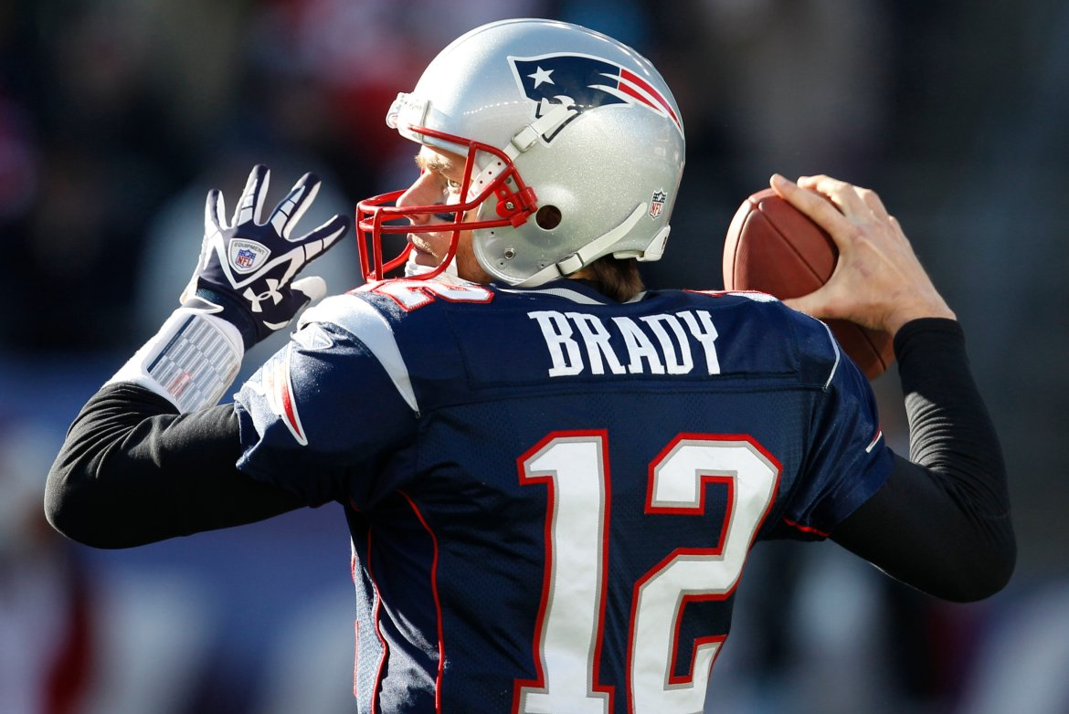 New England Patriots quarterback Tom Brady (12) in the first half of an NFL football game against the Miami Dolphins in Foxborough, Mass., Saturday Dec. 24, 2011. (AP Photo/Charles Krupa)