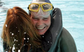 Natalia Molchanova after setting a new World record, holding her breath underwater for 7 minutes and 16 seconds, during the static apnea women final event at the 1st Individual World Freediving Championship in August 2005.    Photo: AP