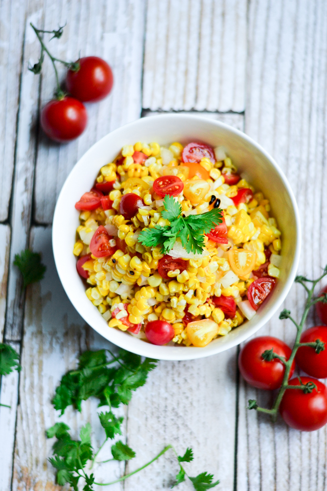 A bright summer salad made with chargrilled corn, cherry tomatoes, and sweet Vidalia onions!