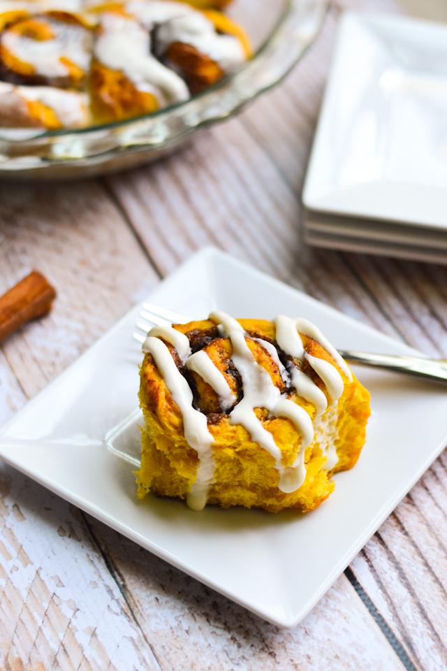 These Glazed Pumpkin Cinnamon Rolls are the perfect indulgence for fall!