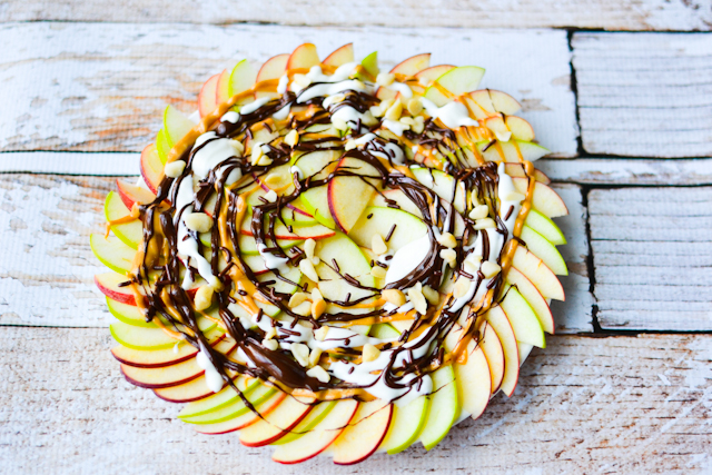 A healthy take on dessert nachos! Thinly sliced apples drizzled in deliciousness!