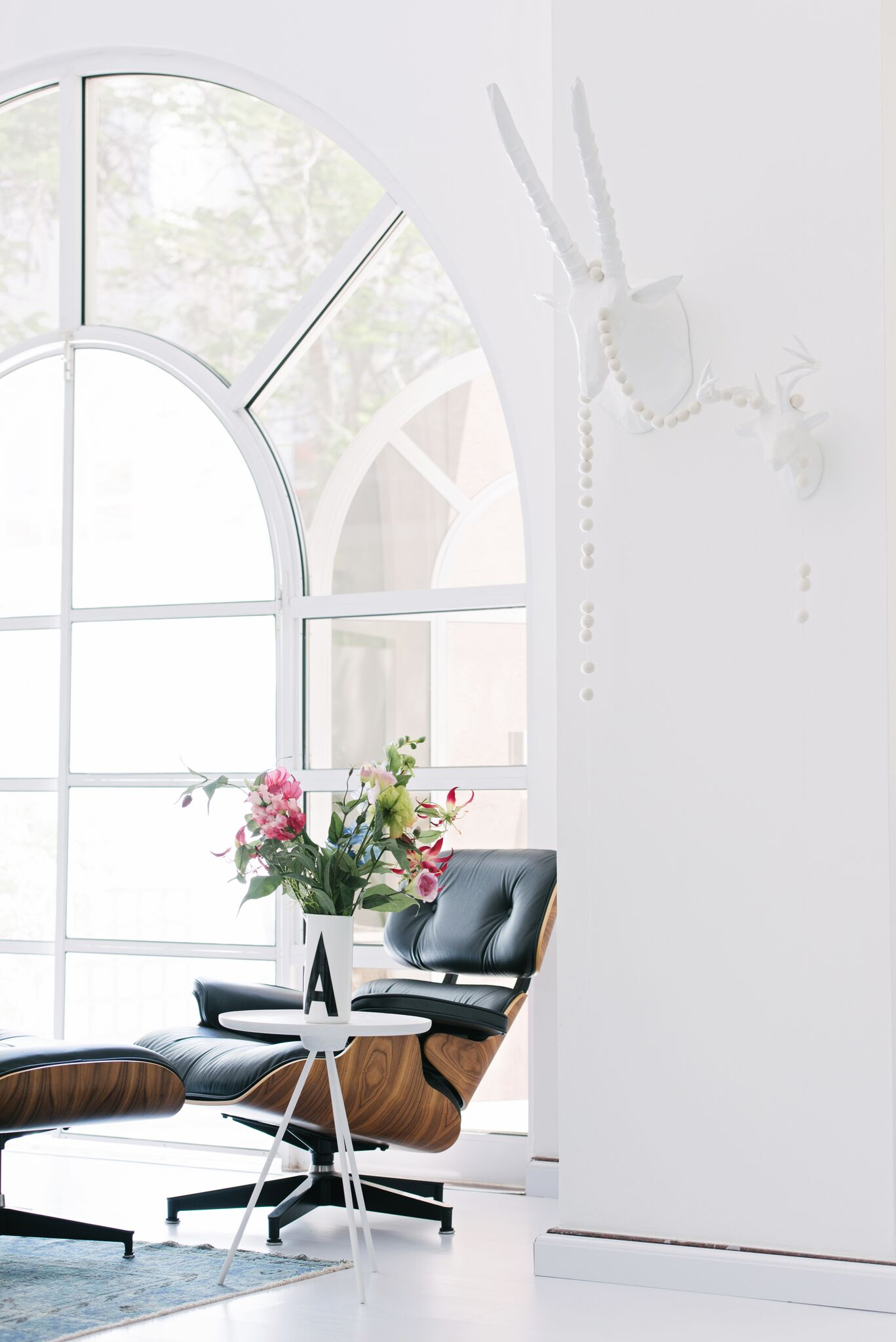 Scandinavian Style Living Room Leather Lounge Chair Next To A Window