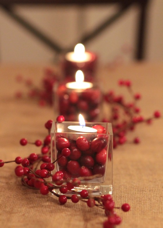 Holiday centerpiece - glass vases filled with cranberries