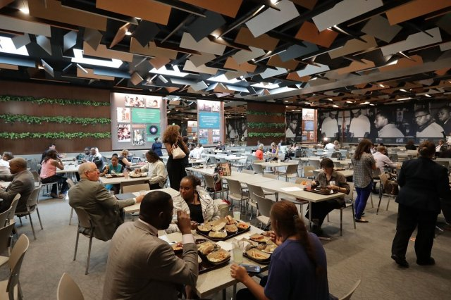 WASHINGTON, DC - SEPTEMBER 14: Guests sample dishes like Son-of-a-Gun stew, pan-roasted oysters, smoked haddock, corn croquettes with a gribiche sauce, slow cooked collards and other traditional foods at the Smithsonian's National Museum of African American History and Culture's Sweet Home Cafe September 14, 2016 in Washington, DC. Filled with exhibits and artifacts telling the story of the first Africans in the United States and their descendents, the 400,000-square-foot museum will open to the public on September 24. (Photo by Chip Somodevilla/Getty Images)
