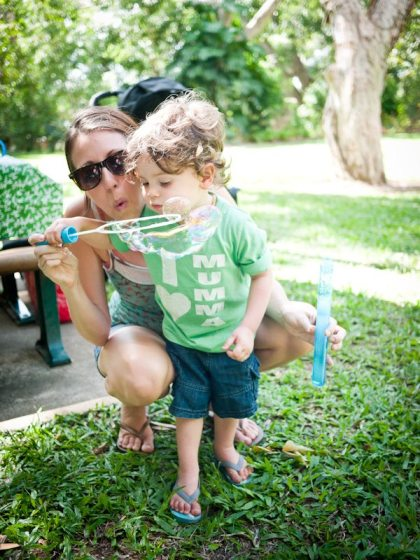 perfect mom enough with boy blowing bubbles