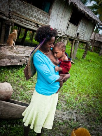 Mother nursing. Women of Bamio, Western Province, PNG.