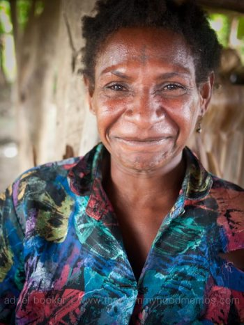Josephine giggling in Bamio, Western Province, Papua New Guinea.