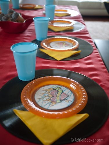 Rockstar Kids Birthday Party table decorations - use a record for place settings