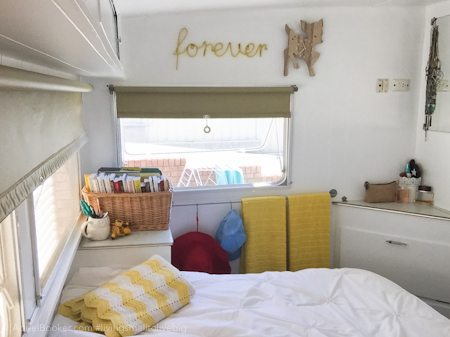 "Adriel Booker - Living in a Caravan-Camper - ""master"" bedroom area and ""bathroom"" area"