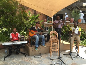 Live music in the outdoor garden at Mille Collines