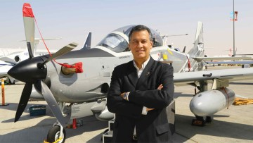 Embraer Commercial senior vice president José Luis Molina strikes a pose in front of his company's just-arrived A-29 Super Tucanol