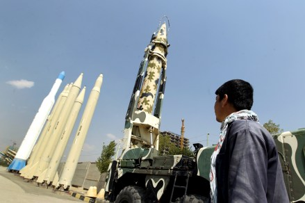 A man looks at Iranian-made missiles at Holy Defence Museum in Tehran on September 23, 2015.