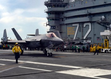 180825-N-AG490-0699 ATLANTIC OCEAN (Aug. 25, 2018) An F-35C Lightning II assigned to the Rough Raiders of Strike Fighter Squadron (VFA) 125 moves across the landing platform on flight deck of the Nimitz-class aircraft carrier USS Abraham Lincoln (CVN 72). Abraham Lincoln is currently underway conducting carrier qualifications. (U.S. Navy photo by Mass Communication Specialist Seaman Maxwell Anderson/Released)