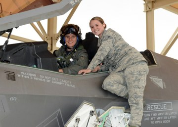 F-35 female pilot Maj. Rachael Winiecki, 461st Flight Test Squadron F-35 test pilot (left), and Airman 1st Class Heather Rice, 412th Aircraft Maintenance Squadron crew chief, after Winiecki landed her F-35 Lightning II on her first test mission flight during December2018. (Image: US Air Force/Kenji Thuloweit)