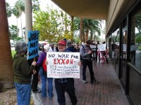 AfGJ's Chuck Kaufman joins others outside the Tucson office of Senator John McCain to protest oil war in Syria