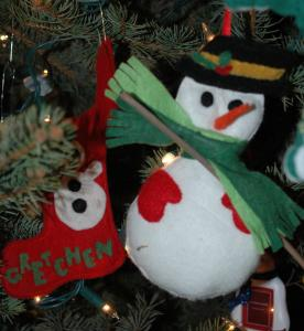 The stocking was made by my aunt years ago.  I made ones for my family to match.  The marvelous snowman is one of my favorites made by my mother.