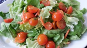 Salad of orange cherry tomatoes, carrots, and Bibb lettuce with Roasted Walnut Oil Dressing (Photo Credit: Adroit Ideals)