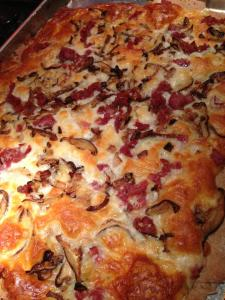 Cremini mushrooms and crispy sauteed prosciutto top a cheesy pizza (Photo Credit: Adroit Ideals)