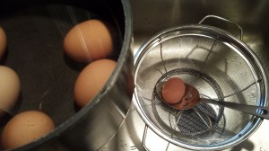 Use a slotted spoon to remove the eggs to a colander (Photo Credit: Adroit Ideals)