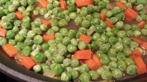 Add the peas to the carrots and onions (Photo Credit: Adroit Ideals)