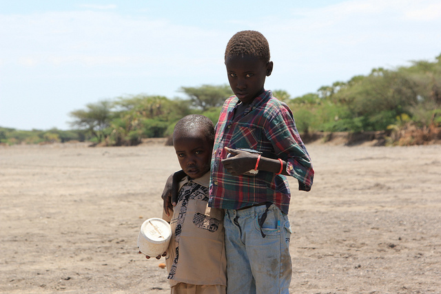 Two brothers aged four and seven seek water in a dry riverbed near Kataboi village in remote Turkana in northern Kenya. In 40 degree heat and no access to clean water, the boys resort to digging holes in the riverbed with a tin cup to scoop up enough to drink. The lack of rain this year across the Horn of Africa has resulted in failed crops, lack of water and death of livestock. The Government of Kenya declared the drought a national disaster as 3.5 million people in the country are in need of emergency assistance.
