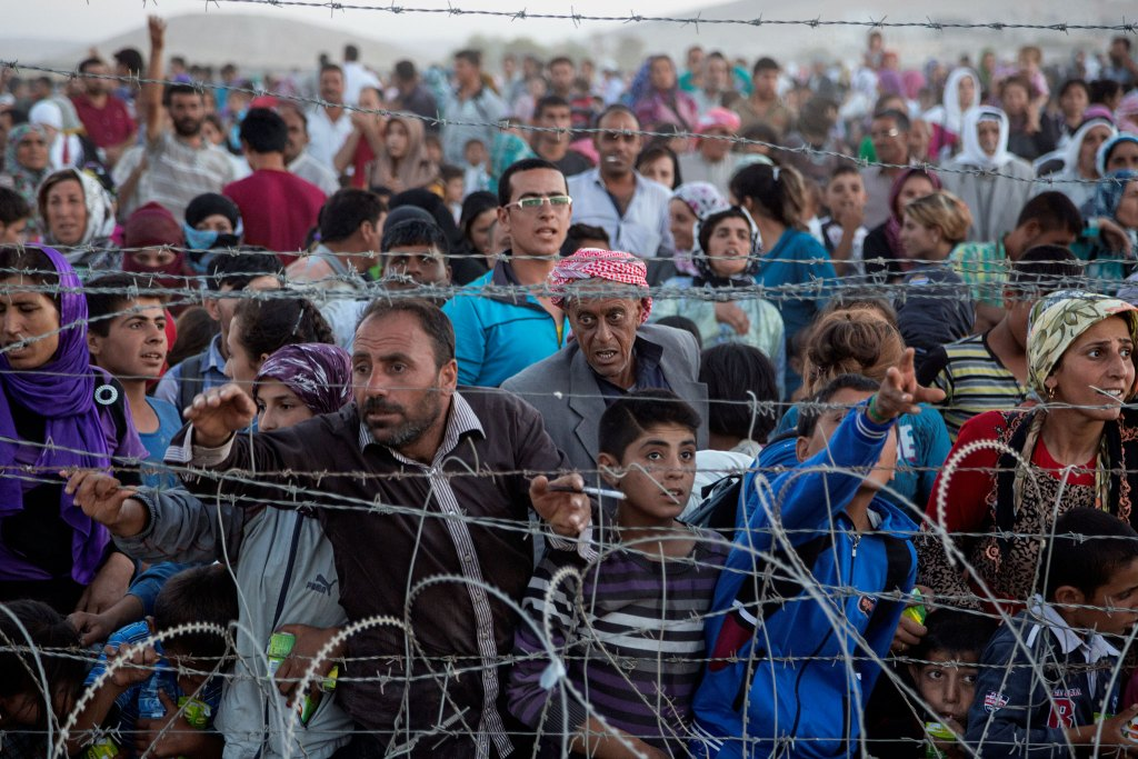 Up to 5,000 Syrians from Kobani amass at the border with Turkey on Friday evening, next to the Turkish village of Dikmetas. On this day was the beginning of the exodus when 200,000 Syrian's, mostly Kurds, crossed into Turkey in 72 hours.