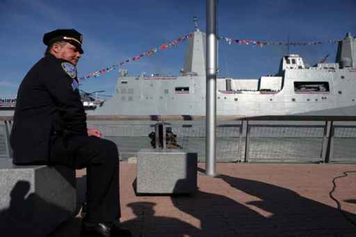 ESPN's Mike and Mike will board the USS New York, which Port Authority Sgt. Christopher Bergman, a 9/11 first responder , sits in front of during her commissioning ceremony Nov. 7 (AP photo)