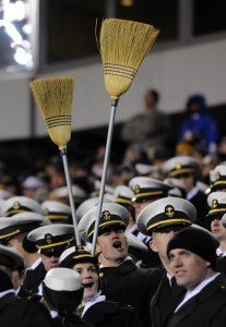 A Navy midshipman brought along a pair of brooms to celebrate the Naval Academy's record 8th win in a row over the Army team from West Point. Army hasn't won a game in the Army-Navy game series since 2001.