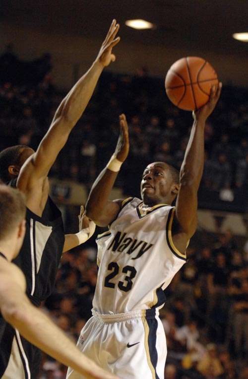 Navy's O.J Avworo takes a shot during the Midshipmen's 62-56 win.  (Tom Brown/ Staff)