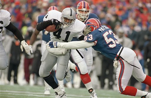 Napoleon McCallum is seen running the ball for the Los Angeles Raiders in Jan. 1994 playoff game against Buffalo. (AP Photo/Mark Duncan)