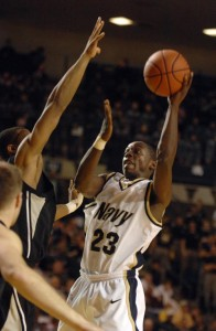 Navy's O.J Avworo takes a shot during the Midshipmen's 62-56 win over Army last month.  (Tom Brown/ Staff)