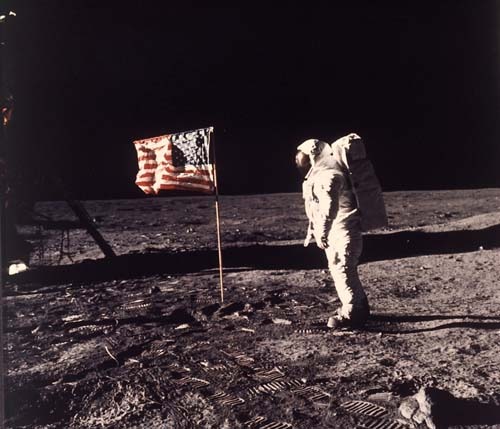 """""""Buzz"""" Aldrin poses for a photograph with the U.S. flag during the moon landing on July 20, 1969. (AP Photo/Neil Armstrong, NASA, file)"""