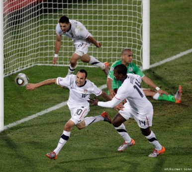 Landon Donovan celebrates after his goal against Algeria lifts the U.S. to the Round of 16. (AP photo)